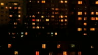 Multi-story housing at evening with windows lighting video