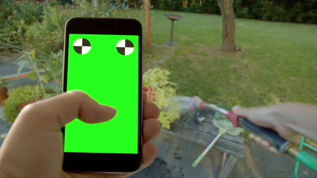 Multi-tasking gardening garden surfing texting human hand green screen chromakey video