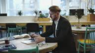 Multitasking man working in modern office video