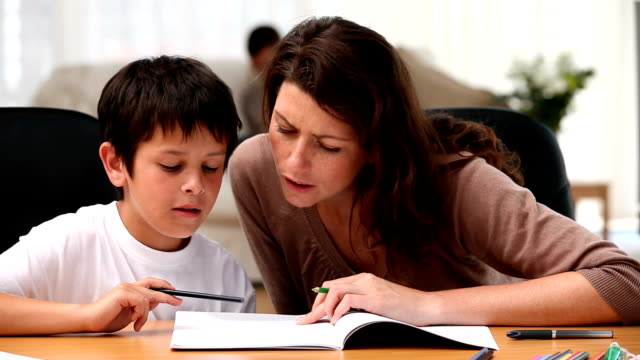 Mum doing homework with her son video