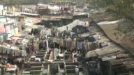 Mumbai, India. Slum, people doing laundry. video