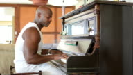 Muscular African piano player video