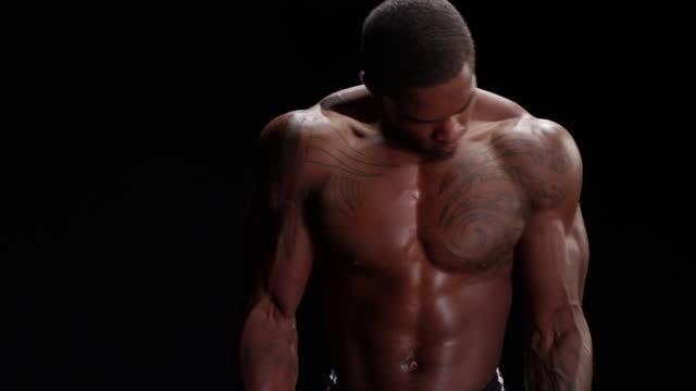 Muscular black man curling a weight bar video