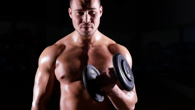 Muscular Bodybuilder Guy Doing Exercises With Dumbbells video