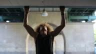 Muscular man doing push-ups at colonnade video