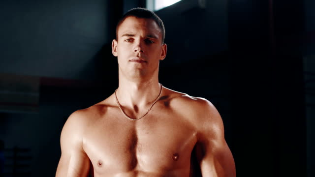 Muscular man posing topless video