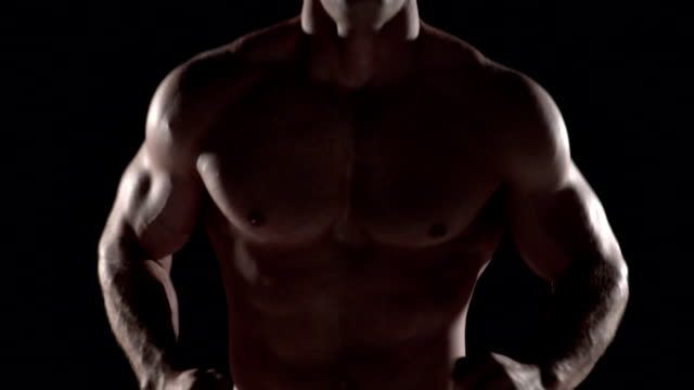 Muscular man running towards camera, torso shot center video