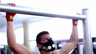 Muscular Men Doing Chin-Ups in the Gym with oxygen mask video