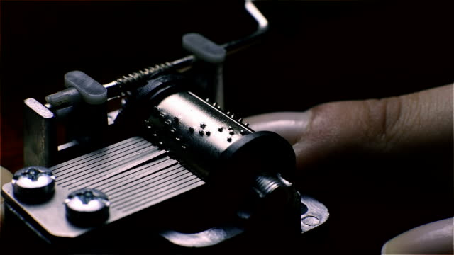 Music Box, a small hand operated. Close up video