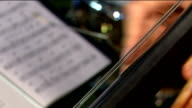 Music CU hand playing kontrabass and notes video
