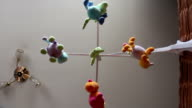 musical baby mobile with soft toys rotate above baby cot video