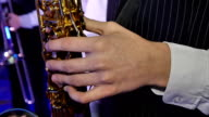 Musician is playing on saxophone video