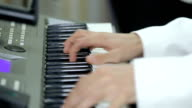 Musician is playing the piano. Close up video