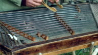 Musician play on traditional cimbalom. Traditional musical instrument video