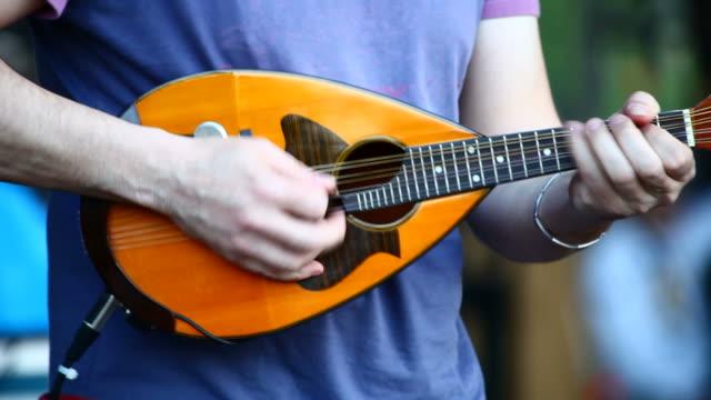 Musician playing a mandolin video
