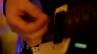 Musician playing an Electric guitar musical instrument at Gig Concert - Stock Video video
