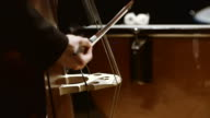Musician playing double bass during concert video