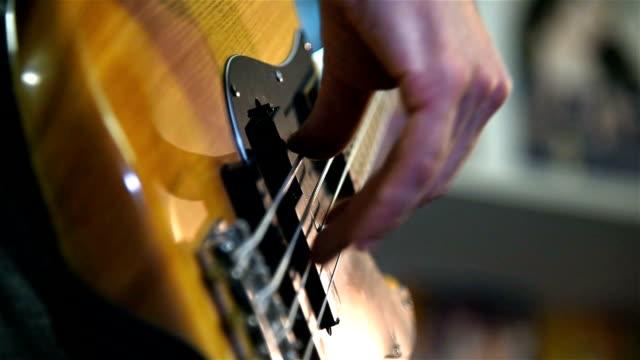 Musician Playing On A Bass Guitar video