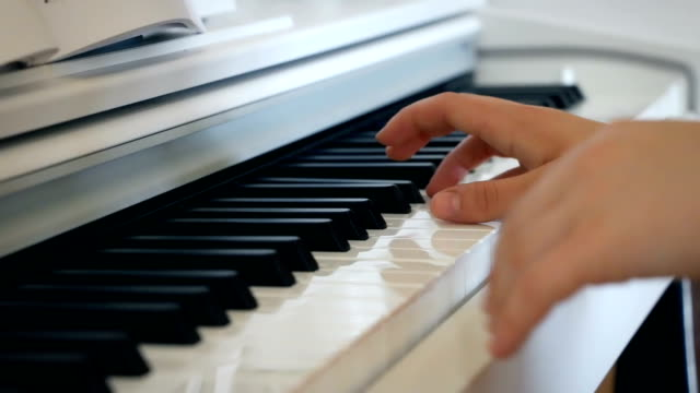 A musician plays the piano in bright room video
