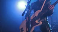 Musician singing and playing the bass on stage. video