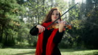 A musician with a bright appearance. Playing the violin video