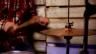Musician with drumsticks playing drums and cymbals video