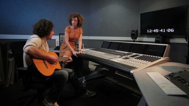Musicians in recording studio video
