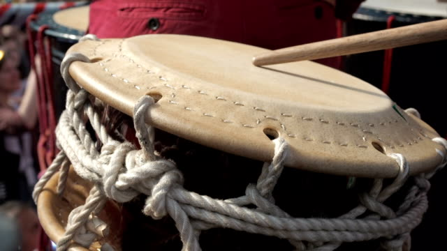 Musicians play the taiko shime-daiko drums on scene During the japanese festival. Close up view video