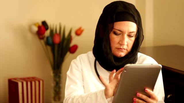 Muslim doctor working with digital tablet video