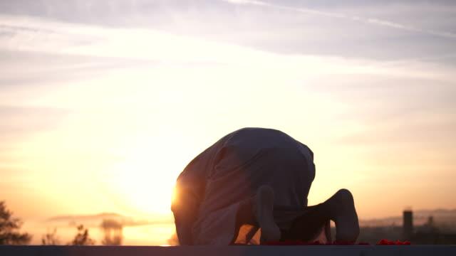 HD: Muslim Man Prostrating At Sunrise video