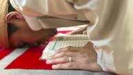 HD: Muslim Man Prostrating With Koran video