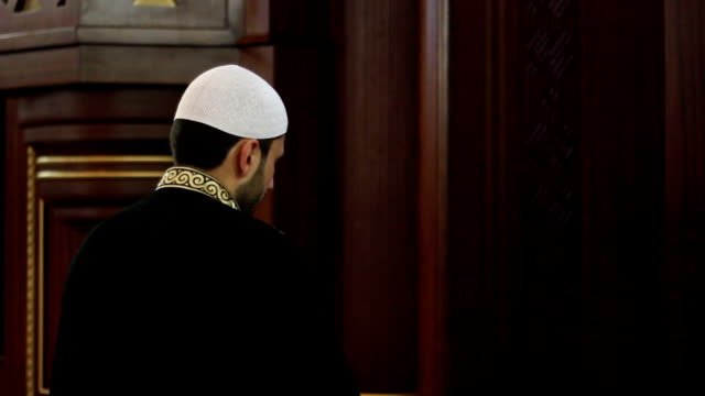 Muslim reverend worship in a mosque with his traditional robe video