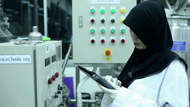 Muslim Scientist working at laboratory video
