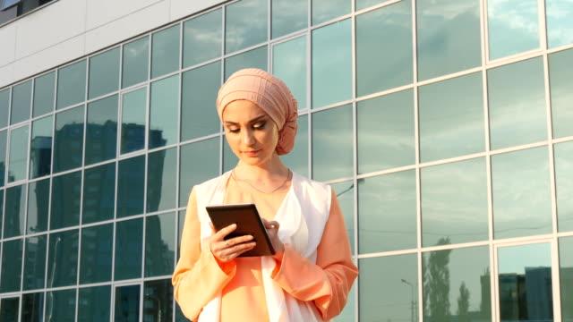 Muslim woman use tablet video