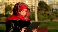 Muslim woman using digital tablet video