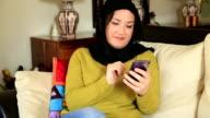 Muslim woman using smart phone video