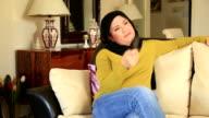 Muslim woman watching tv video