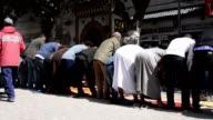 Muslims praying Allah in the main Friday prayer on a street Essouira video