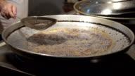 HD: Mussels frying in oil in a pan video