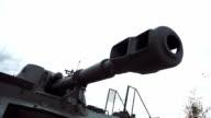 Muzzle brake compensator of tank gun on background of sky video