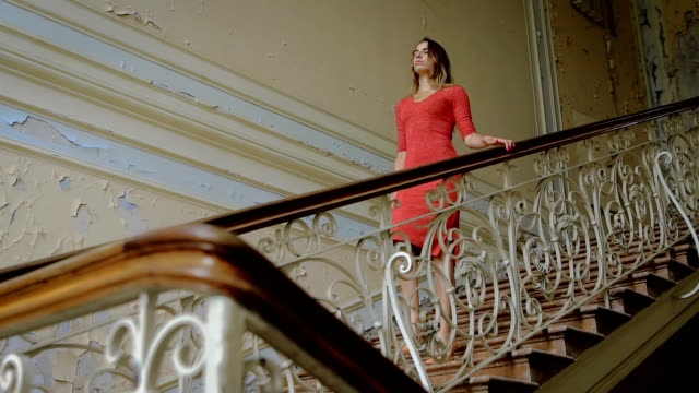 Mysterious and frightening place. The girl in the red dress up the old stairs video