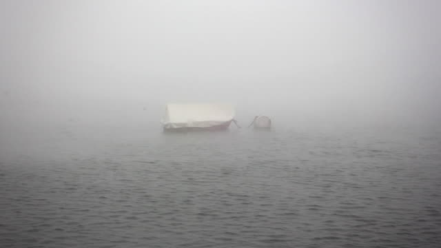Mysterious boat floating on foggy lake video