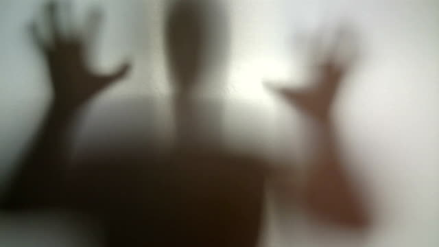 Mysterious silhouette with hands up and down, person in stress video