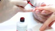 Nail technician at nail salon video