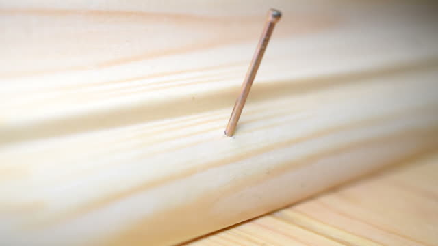 Nailing a wooden skirting board in place video