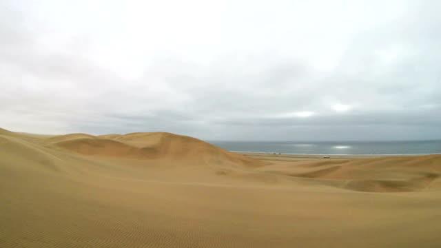 Namib Desert meets the Atlantic Ocean. Dunes of the Namib Desert stretching along the Atlantic Ocean, Namibia video