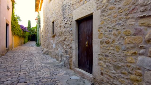 Narrow street in old medieval town of Peratallada, Spain video