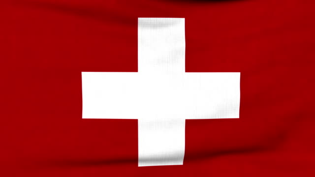 National flag of Switzerland flying on the wind video