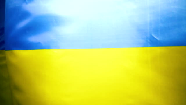 National flag of Ukraine fluttering in the wind. Slow mo video