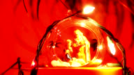Nativity scene in a Christmas ball with lights video